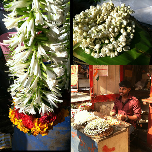 handcrafting flower garlands at the Dadar flower market, Mumbai, India