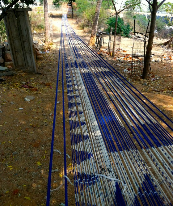 Weavers outside Hyderabad, India making impossibly long cloth.