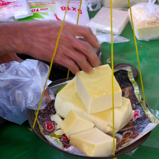 Weighing fresh tofu at Inle Lake's market