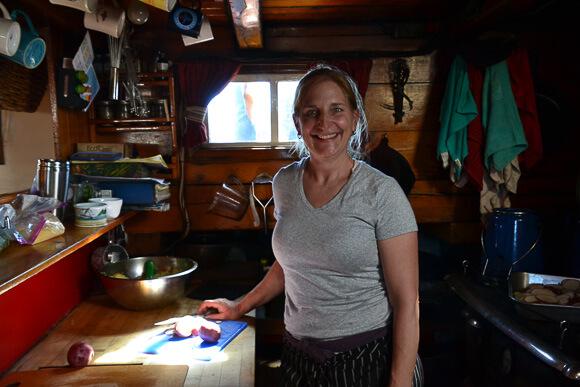 Chef Annie Mahle in her kitchen aboard the J&E Riggin