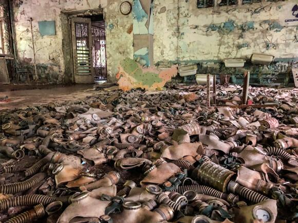 Dark Tourism gas mask graveyard in school building at Chernobyl