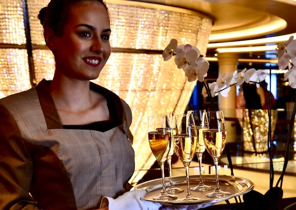 woman holding tray of champagne