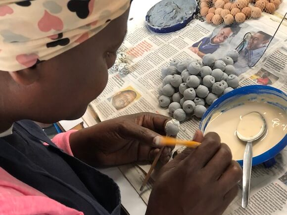 woman working on beads