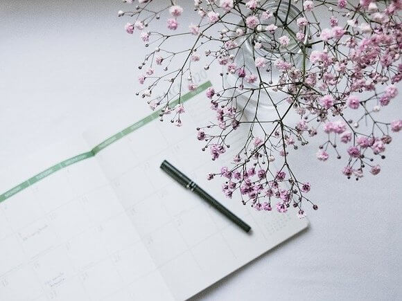 small business ideas notepad and flowers