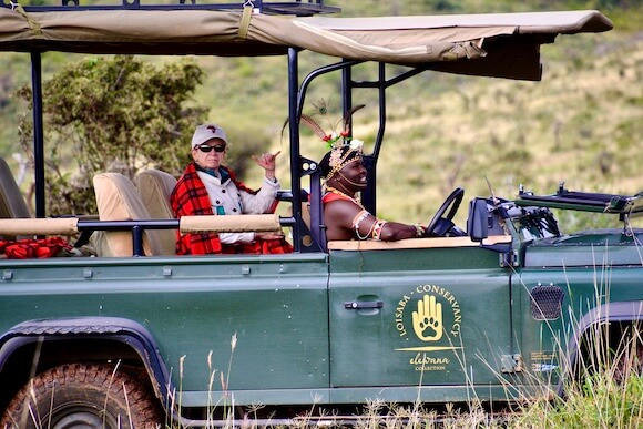 vehicle, guest and driver at Loisaba tented camp