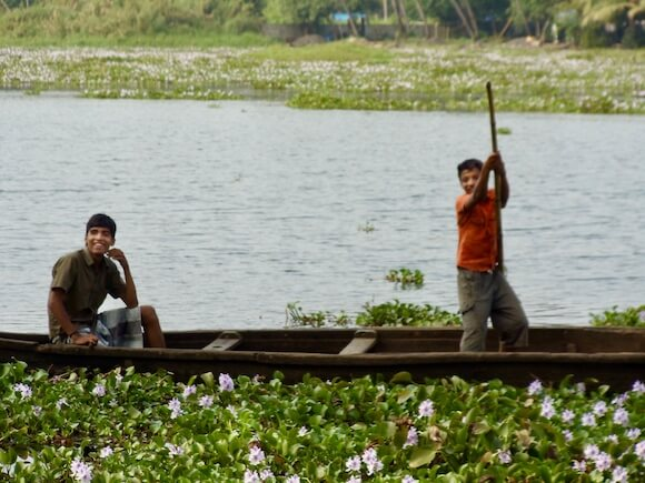 traditional boat in Kerala with two boys