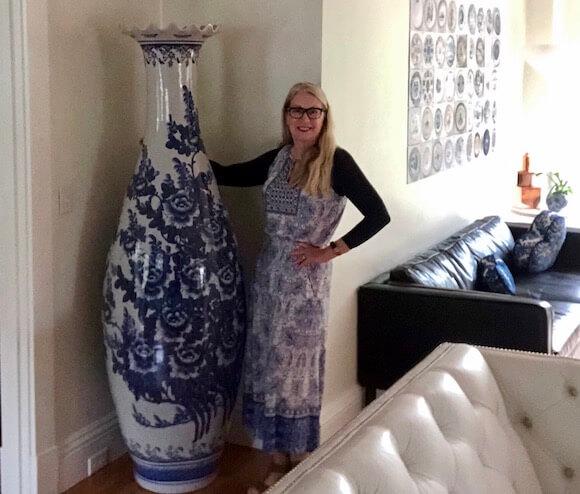 Woman with vase in living room Nobnocket Inn