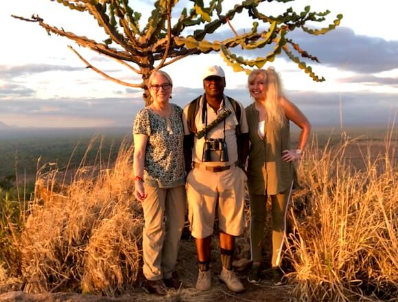 guide and two women hiking
