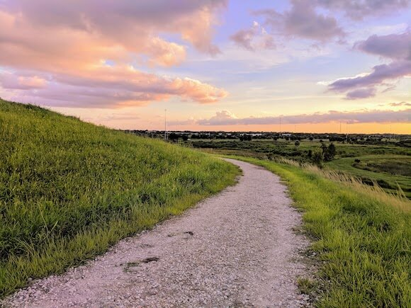 sunset along path in field