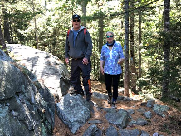 man and woman hiking Mt. Battie