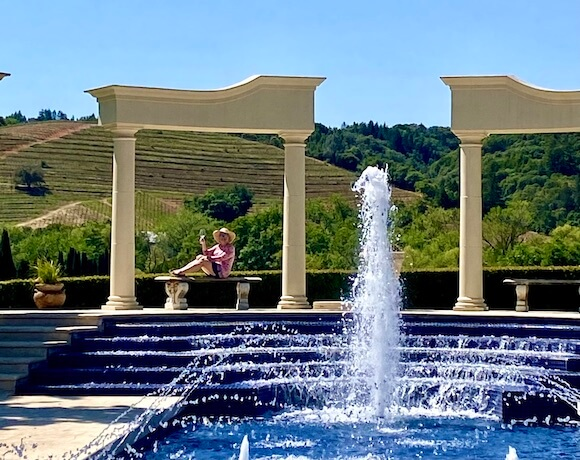 woman sitting on bench at Ferrari Carano sustainable winery