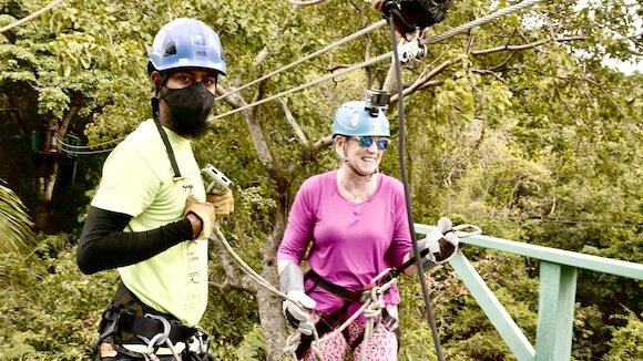 guide with a woman zip lining