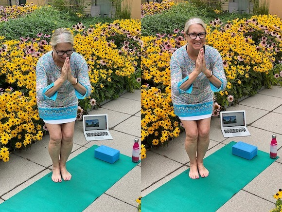 woman saying namaste at the end of yoga class